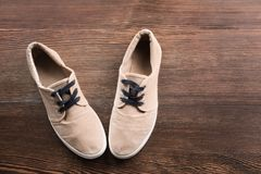 Casual male shoes. On wooden floor Royalty Free Stock Photo