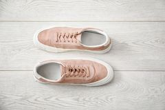 Casual male shoes. On wooden floor Stock Images