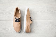 Casual male shoes. On wooden floor Stock Image