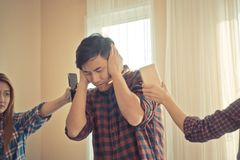 Casual male stressed out from telephone ringing Royalty Free Stock Images
