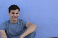 Casual male student at college looking happy with copy space Royalty Free Stock Images