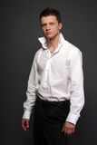 Casual man. In white shirt on gray Royalty Free Stock Image