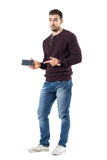 Casual man advertising blank black smart phone screen Royalty Free Stock Images