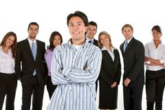 Casual man amongst business people Stock Images