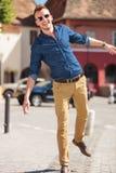 Casual man balancing in city Royalty Free Stock Image