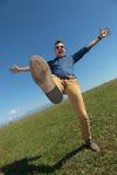 Casual man balancing outdoors Royalty Free Stock Photography