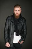 Casual man with beard wearing leather jacket. Image of stylish casual modern man with beard wearing leather jacket and looking at camera Stock Images