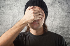 Casual Man with Black Cap covering face royalty free stock photos