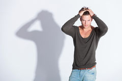 Casual man with both hands in hair Royalty Free Stock Photography