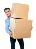 Casual man with boxes. On the white background Royalty Free Stock Photo