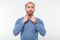 Casual man buttoning his shirt Royalty Free Stock Photo