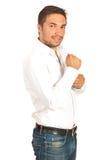 Casual man buttoning-up sleeve shirt Stock Image