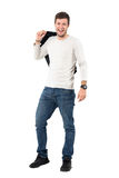 Casual man carrying jacket over shoulder laughing and looking at camera Royalty Free Stock Photos