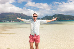 Casual man celebrating freedom on the beach Royalty Free Stock Image