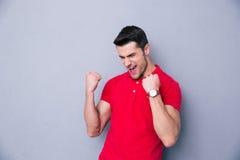 Casual man celebrating success Stock Photo