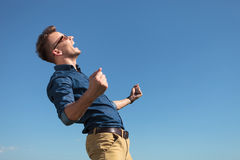 Casual man cheering outdoors Stock Images