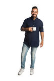 Casual man with a coffee mug Stock Images