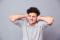 Casual man covering his ears Stock Images