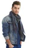 Casual man in denim jacket. Handsome casual man standing in denim jacket, smiling Stock Photo