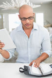 Casual man with digital tablet and diary at home Stock Image