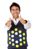 Casual man doing the thumbs up sign Royalty Free Stock Image
