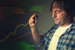 Casual man drawing a rising chart Stock Photography