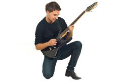 Casual man with electronic guitar Royalty Free Stock Image