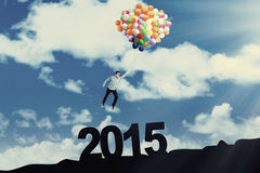 Casual man flying above number 2015 Stock Images