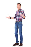 Casual man gesturing welcome Royalty Free Stock Photo