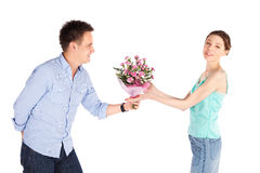 Casual Man Giving Flowers to Girlfriend. Cheerful happy casual couple isolated on white, romantic man giving flowers to his girlfriend Stock Photos