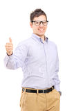 Casual man with glasses giving a thumb up Stock Photo