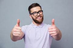 Casual man in glasses showing thumb up Royalty Free Stock Image