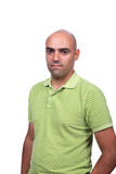 Casual man with green polo shirt. Casual bald man with green polo shirt isolated over white background Stock Image