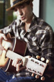 Casual man with guitar a Stock Photography