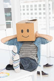 Casual man with happy smiley box over face at office Stock Photography