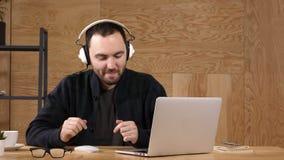 Casual man in headphones listening music. stock video