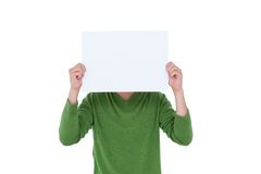 Casual man hiding his head with blank paper Royalty Free Stock Images