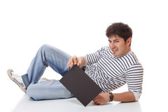 Casual man holding an add Stock Image