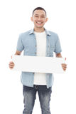 Casual man holding blank white board Stock Photography