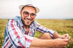 Casual man holding a flower and laughing Stock Photography