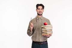 Casual man holding glasses and books. Portrait of a casual man holding glasses and books isolated on a white background Stock Photo