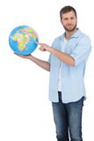 Casual man holding a globe Royalty Free Stock Photography