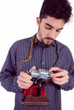 Casual man holding his camera Royalty Free Stock Photos