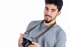 Casual man holding his camera Stock Photo