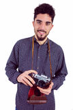 Casual man holding his camera Royalty Free Stock Photo