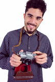 Casual man holding his camera Royalty Free Stock Images