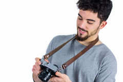 Casual man holding his camera Stock Image