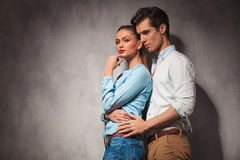 Casual man holding his girlfriend by waist Stock Image