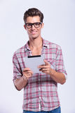 Casual man holding his tablet Stock Image