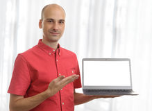 Casual man holding laptop computer Royalty Free Stock Photo
